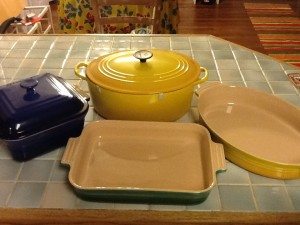 Le Creuset cast iron oven and three different bakers.Don't mix them up and put the bakeware on the stove!